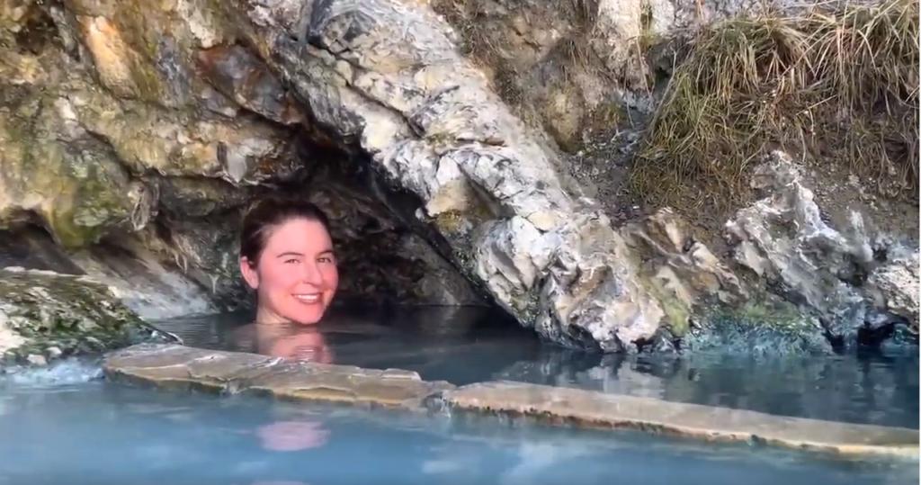 A woman enjoying a Colorado hot spring.